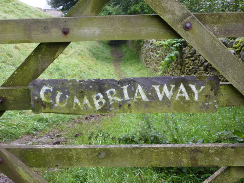 Slate sign on gate saying 'Cumbria Way'