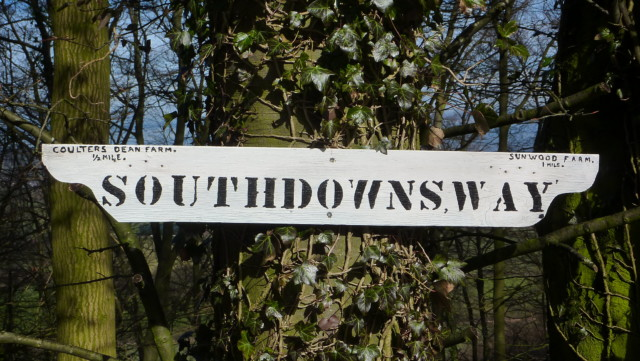 A wooden South Downs Way signpost