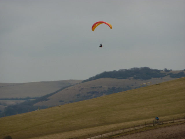 A paraglider above Truleigh Hill