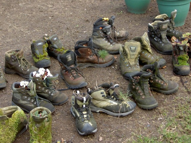 Old hiking boots used as flower pots at Kirk Yetholm, near the end of the Pennine Way
