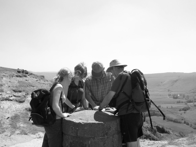 Walkers consult a map near Edale