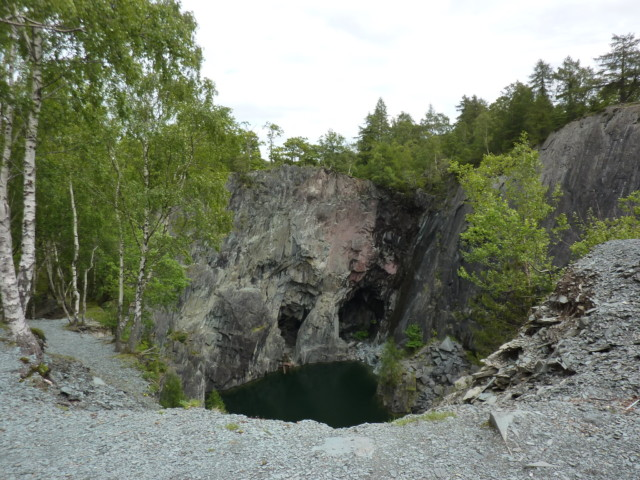Holes in the rock looking like a face at Hodge Close Quarry