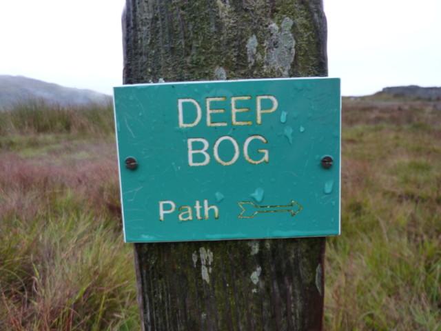 Plastic sign saying 'deep bog'