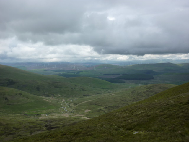 Windfarm in the distance in a valley