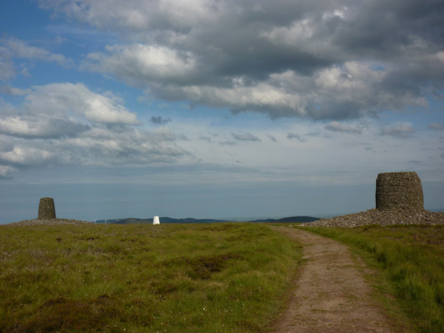 The two giant cairns known as Twin Law, with a white trig point in between