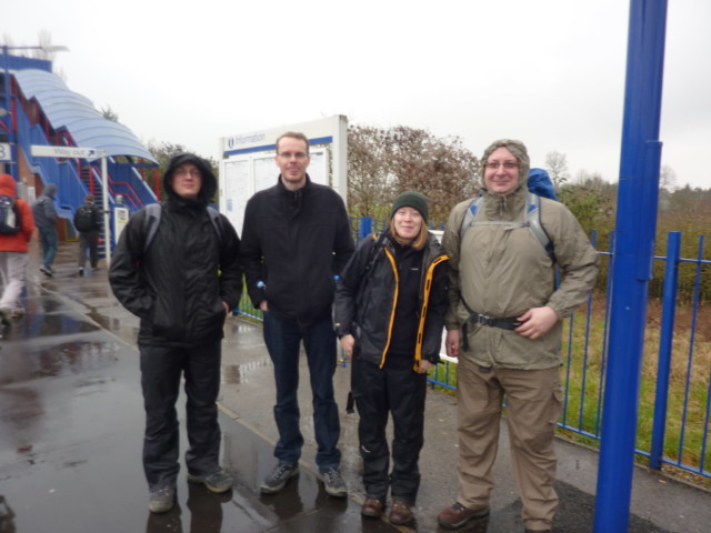 Four walkers huddling in the rain at Princess Risbrough