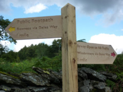 Signpost saying 1 mile to Bowness on the Dales Way