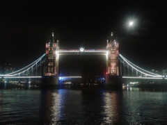 An illuminated Tower Bridge, seen at night