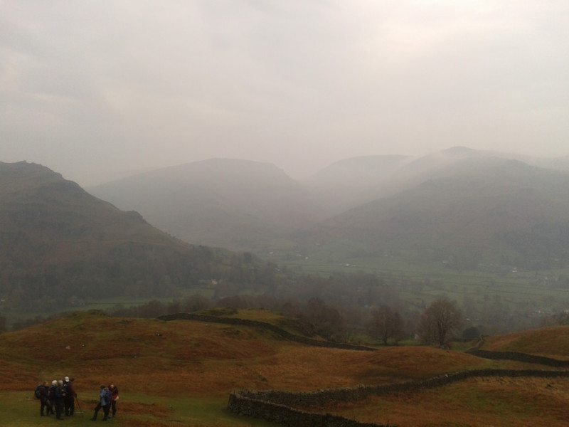 Group of walkers admiring the view of Grasmere from part way up Silver How