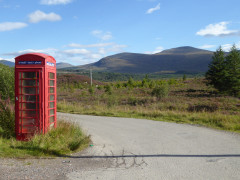 Red telephone box at the turnoff for Tulloch railway station