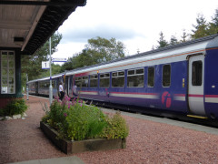 Scotrail train standing at Tulloch station