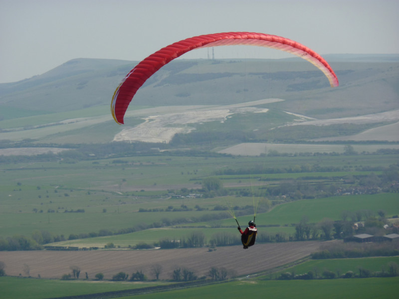 Paraglider in the South Downs, with Truleigh Hill in the background