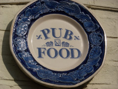 Ceramic plate saying 'pub food'