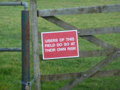 Small sign saying 'Users of this field do so at their own risk'