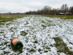 Empty bottle of Bucks Fizz, strewn on a snow covered field in Oxfordshire