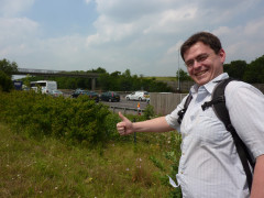 A good friend stands next to the M25 whilst on a walk