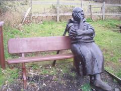 Pilgrim statue sat on a bench