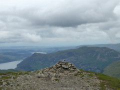 The summit cairn at Dollywagon Pike, with view towards Ullswater