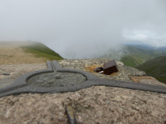A padlock attached to Helvellyn's trig point