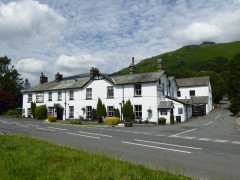 The Swan Hotel in Grasmere, with Stone Arthur behind it