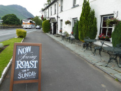 Sign outside the Swan Hotel saying 'Now Serving Roast on a Sunday'