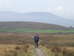 Walking along the Pennine Way near Dismal Hill