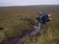 Jumping over a stream on Stonesdale Moor