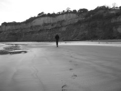 Walking away on the sand of Shanklin beach on the Isle of Wight