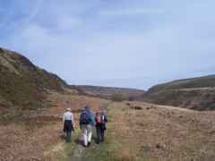 Catherine and her parents, walking the Pennine Way at Black Tor
