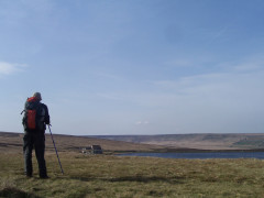 Catherine standing near Redbrook Reservoir, on the Pennine Way