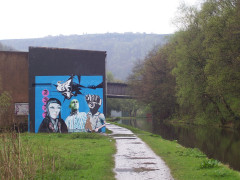 The Spirit of 69 mural on the canalside at Hebden Bridge