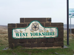 Battered and faded sign saying 'West Yorkshire'