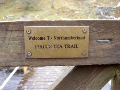 Sign on a gate saying 'Isacc's Tea Trail' [sic]