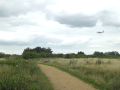 A plane flies low over Hounslow Heath