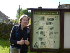 Standing next to the Pennine Way information board at Byrness