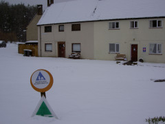 YHA sign buried in the snow at Byrness