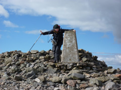 Holding onto the trig point at Windy Gyle