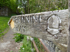 Worn Pennine Way sign at Edale