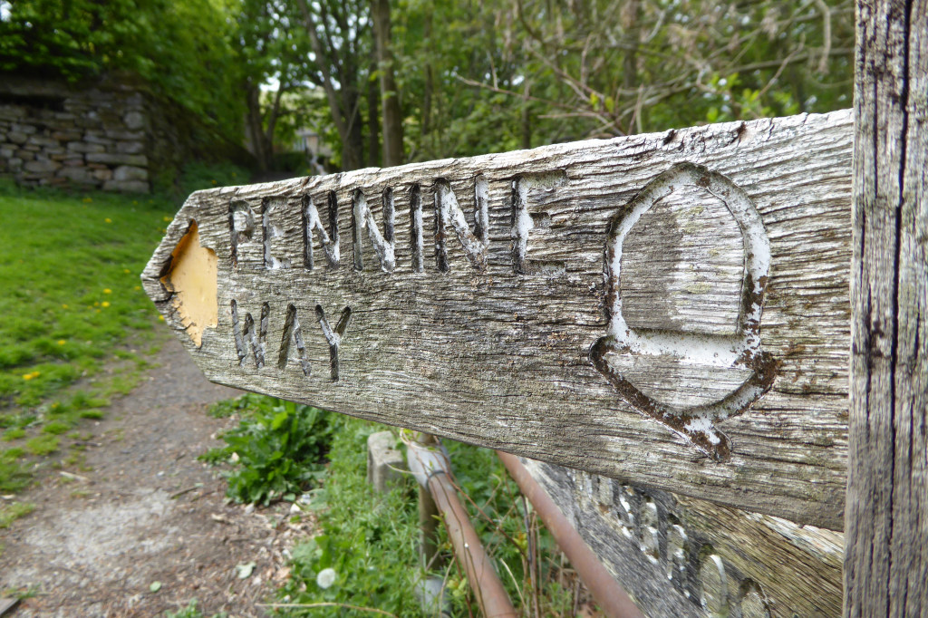 A well worn Pennine Way sign at Edale