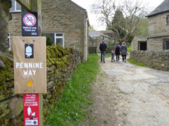 Pointing in the direction of the Pennine Way's start at Edale