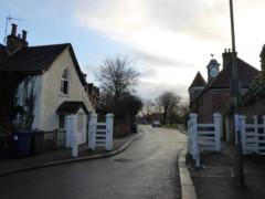 White gates on the edge of Monken Hadley