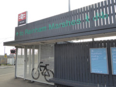 Large sign above railway station saying 'To Rainham Marshes'