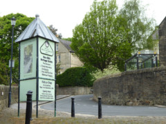 Sign for New Mills Heritage Centre