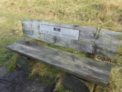 Bench with the caption 'After clouds, sunshine'