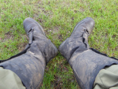 A pair of muddy boots and gaiters