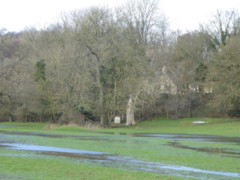 Flooded field, and the stone marking the source of the Thames