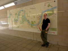 Me, standing next to a giant map of the Thames, in a subway