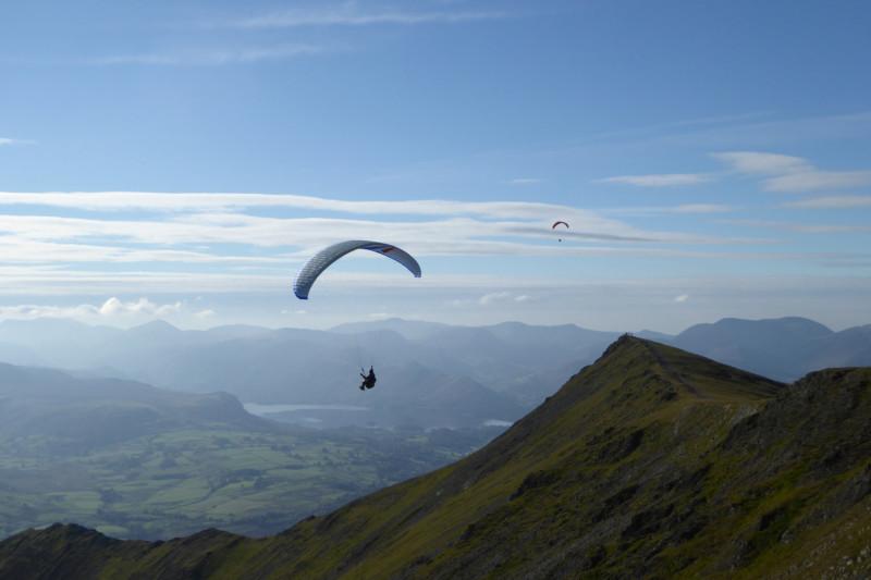 Paragliders flying above Blencathra
