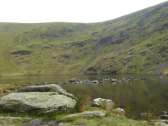 Large rock at the edge of Bowscale Tarn