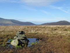 Cairn – and puddle – at the summit of Mungrisedale Common